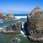 Oregon Coast, ocean rock formation divide.